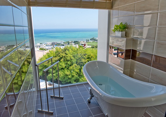 A bath with an amazing view in all guest rooms