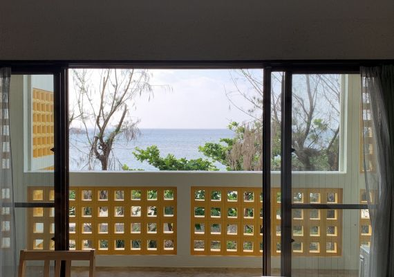 It is view from room on the second floor. As there is windbreak forest between building and the sea, there is change of view for other rooms, growth of the trees and plants more.