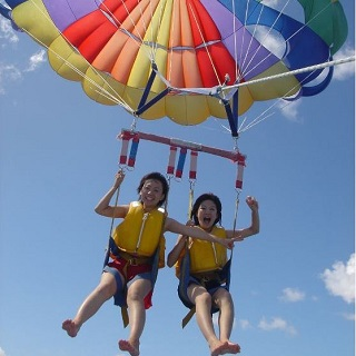 <<Parasailing>> Soar in the sky and enjoy a bird's eye view of shimmering blue ocean with 120% of adrenaline rush!!